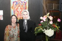 Zahra Nazarbageh and Laurie with Buddha painting at NAC reception